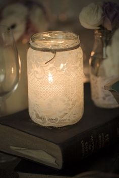 Mason Jar Lantern - temporarily adhere lace and spray paint over it to create a lace pattern that is sturdier