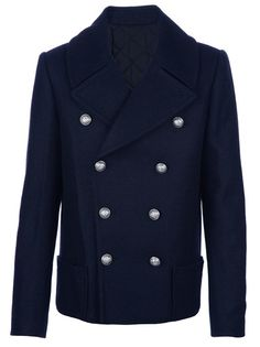 Blue wool double breasted pea coat from Balmain featuring a silver-tone maritime themed front button fastening, wide notched lapels, long sleeves with buttoned cuffs and two patch pockets to the front.