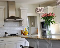 Isabella & Max Rooms: Kitchen Redesign--love the lights and the tall vase of flowers