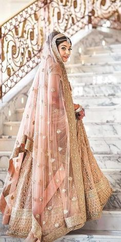 Indian wedding dresses are very beautiful. Usual indian bridal dresses made of chiffon or silk and adorned with elaborate embroidery, red or gold color. Indian Bridal Outfits, Indian Bridal Lehenga, Indian Bridal Fashion, Indian Dresses, Bridal Dresses, Designer Bridal Lehenga, Wedding Lehnga, Dress Wedding, Bollywood Wedding