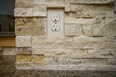 how to cut stone backsplash around outlets