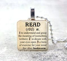 "Read Dictionary Definition Necklace - Book Lover Bookworm Librarian Teacher 1 inch Wood Tile - Book Club Reading Jewelry  We use only high quality materials, including non-toxic crystal clear resin for that ""glass-like"" finish over the front image. Wood Pendants are approximately 1 inch x 1 inch square.  Other chains and add ons are available here: https://www.etsy.com/shop/LittleGemGirl?section_id=8083365.  See Shop Announcement for the latest updates, current produc..."