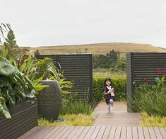 It's just like the tropics in this lush Orewa garden - Homes To Love