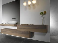 bathroom basin on wood floating shelf, plus separate single storage underneath. Clean lines, air, space, contemporary