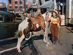 cowgirl in downtown el paso, 1939.
