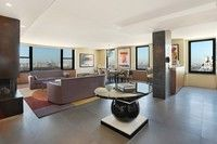 This striking, loft-like contemporary apartment is detailed with superb materials and finishes such as burled Tropical Olive (Mozambique) wood veneers, honed Roman Basalt stone floors and Venetian plaster walls. The commanding, panoramic open west and north views across Central Park. (1001 Fifth Avenue #23A, $5,200,000, Corcoran)