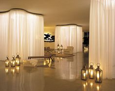 Delano Hotel - Miami, FL. Sheer curtains divide up the space while still allowing some light to come through.