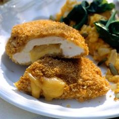 Smoked cheese melts inside chicken breasts for this easy entree. A bread crumb coating gives the chicken golden color and a crispy crunch.
