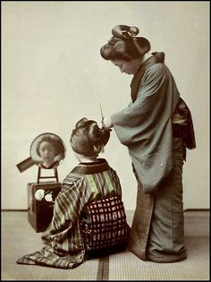 """FIXING THE HAIR in OLD JAPAN-Notice the """"natural"""" state of the Kimono worn by the hairdresser --- her sleeve is already starting to grow loose threads. This was not a big deal with the Japanese, and such roughness is seen in many old photographs of Japan"""