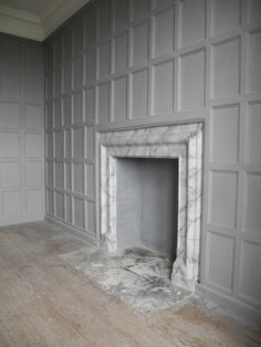 Marble fireplace. Grey panel walls