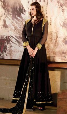 Get a pretty look dressed in this Anarkali suit, georgette fabric in black color accentuated with resham embroidered decorative patterns and border that gives you a simple yet elegant look. #flaredanarkalisuit #anarkalidress #anarkalisuit