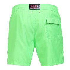 """FLUO GREEN OWNER P SWIM SHORTS WITH SKULL Fluorescent green Long Swim Shorts featuring a skull and """"PIRATES DE SAINT BARTH"""" embroidery at lateral side. Two front pockets and back Velcro pocket. Internal net. Elastic waistband with adjustable drawstring. COMPOSITION: 100% POLYESTER. Model wears size M, he is 189 cm tall and weighs 86 Kg."""