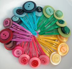 Button clips close up by alipink_handmade, via Flickr