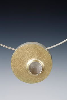 Lona Northener Jewelry:  Hollowform of Sterling and 18K Bimetal.