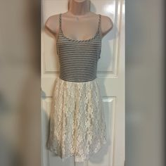 Summer dress Gray and white striped top with lace bottom. Pretty cute huh? Never worn. All with tag.       trade Finn & Clover Dresses