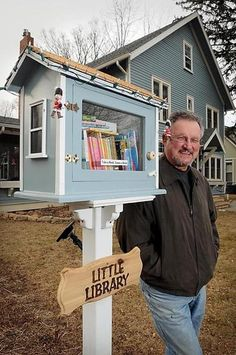 """After seeing what's known as a """"Little Free Library"""" in Faribault, Bruce Blaisdell decided to build his own version of the free book exchange outside his Marshall Street home. The libraries have been popping up all over the world since Todd Bol built the first one in Hudson, Wis."""