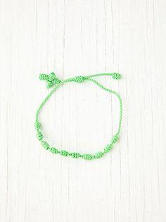 Cross Bracelet  http://www.freepeople.com/accessories-neon-accessories/cross-bracelet/