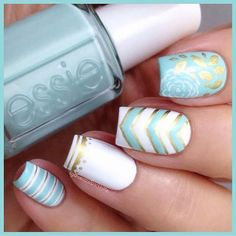 Gorgeous aqua blue and gold nail art look. Love the mix of chevron, floral, and stripes.