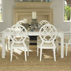 "Ivory Key Extendable Dining Table by Tommy Bahama Home. Overall: 30"" H x 112"" L x 45"" W. Includes 20"" leaf."