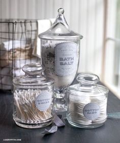 I love these glass canisters with bathroom bits - looks so posh!