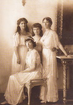 The Romanov girls, standing up in back from left to right: Maria, Anastasia, Olga. Sitting down, Tatiana.