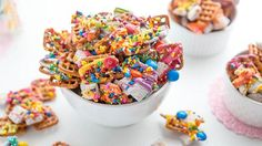 Chocolatey Muddy Buddies® and pretzels get coated with ALL THE COLORS in this super simple, party-perfect rainbow snackable.