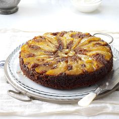 Upside-Down Pear Gingerbread Cake Recipe -The aroma of baking gingerbread stirs up such warm memories. This one looks festive and is even on the lighter side. —Nancy Beckman, Helena, Montana