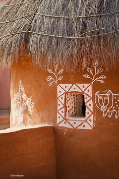 Rajasthani village hut folk art ornamentation by Phil Marion -- Lovely window detail. India.