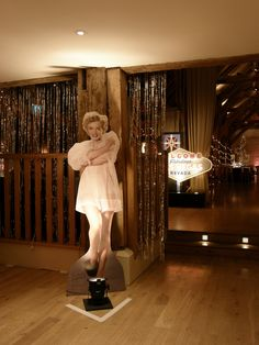 Bury Court Barn Surrey   Shimmer curtains, illuminated Welcome to Las Vegas sign, wall uplighters in pink and white and Marilyn Monroe cut-out by Stressfreehire.com #venuetransformers