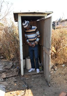 Gugulethu Informal Settlement outside Springs. Sipho Ndamase(22) inside the toilet in Gugulethu Informal Settlement outside Springs. The community do not have flushing toilets, electricity and water. Picture: Dumisani Sibeko