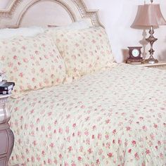 Sleep on a bed of roses with this pretty quilt set that features tiny pink rosebuds. The quilt and two shams are made of pre-shrunk cotton, so you can machine wash them without worry. A scalloped border adds visual interest and imparts a delicate look.