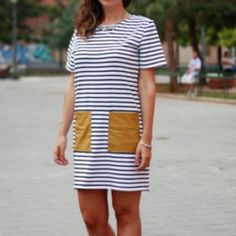 White and black short sleeve striped casual dress Brand new White and black short sleeve striped casual dress. Has faux tan leather pockets! Super soft casual tshirt material that is breathable and lightweight! Definitely not sheer! * picture one is the actual dress * • available in  medium and large • April Spirit Dresses Mini