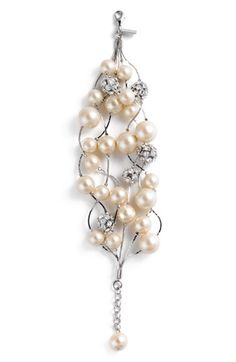 "Pretty pearls and spherical sparkle stations are threaded on shiny silver wires in a handcrafted bracelet finished with a pearl drop extender. Lobster clasp closure. Approx. length: 7 1/2"". Glass stones/glass pearls/rhodium-plated brass."