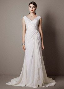 Step back in time with this gorgeous chiffon sheath wedding gown reminiscent of Old Hollywood glamour!  Deep V neckline bodice features sparkling sequin tulle detail.  Chiffon light weight gown with side draped createsa stunning and flattering silhouette.