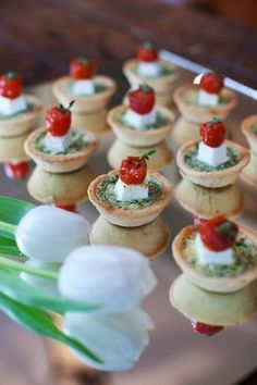 These little tarts look great - pesto, fetta and roasted cherry tomatoes I presume?