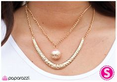 In the Knick of Time Item #: P2RE-PKXX-001XX A thin, curved gold plate with hammered texture along a gold chain is accented by a large light pink bead nestled into a gold fitting along another centered gold chain. Features an adjustable clasp closure.  Sold as one individual necklace. Includes one pair of matching earrings.