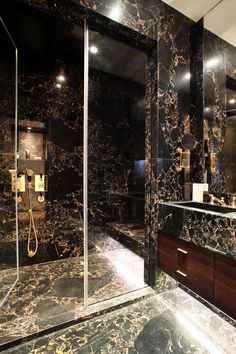 Masculine bathroom. Black marble. Luxury triple lateral apartment, Chelsea. PEEK Architecture + Design. www.peekarchitecture.co.uk