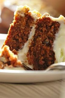 healthy carrot cake made with apple sauce and egg whites instead of butter with cream cheese frosting!