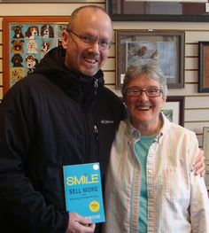 "Jack Lang, Sales Manager for Fish Window Cleaning Company in Southfield, MI, purchased a number of my books at Main Street Art in downtown Milford, MI.   ""SMILE, simply blew me away. It is a must read for anyone intent on improving their business,"" says Jack.  Jack is posing with Barb, owner of Main Street Art."