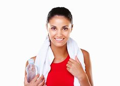 Happy woman is detoxing daily by drinking water and exercising.