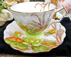 AYNSLEY TEA CUP AND SAUCER WHITE  & WATER LILY FLORAL PATTERN TEACUP CROCUS