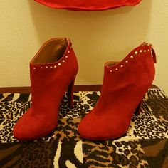 Red suede boots with Gold studs In excellent condition.  I wore them a couple of hours at my home party. Like new , very comfortable. No scratches or marks. Shoes Heeled Boots