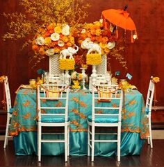 Big, bright flower and elephant centerpieces --- Indian wedding decor