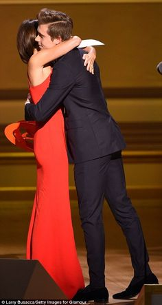PDA moment! The 41-year-old designer warmly embraced the 16-year-old model after he presented her with her Fashion Force trophy onstage Carnegie Hall