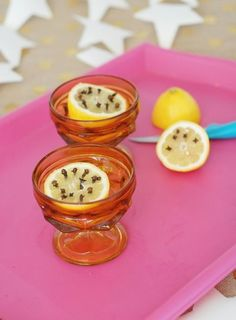 A lemon slice topped with cloves is a natural bug repellant that doubles as table decor.