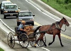 An Amish man merges into traffic in Lancaster County, Pa.