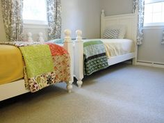 Boy / girl shared bedroom. Love the white beds and colorful quilts.