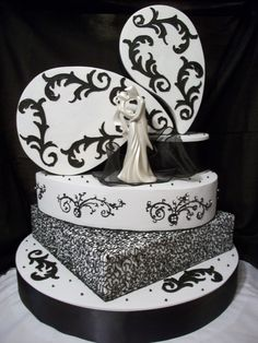 Black & White multi layer cake, desinged with unique layer placement and elegant  decorations of fondant and royal icing create a one of a kind masterpeice.
