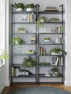 9 Ideas for Creating a Stylish Bookshelf // Greenery --- Plants literally give life to the shelves, and can be a great way to add height and depth to your display. Plus, they help purify the air, making them great for your home environment.