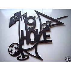 An awesome piece of contemporary wall art. The 19th hole in black steel.